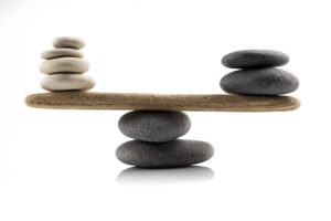balancing stones on white background Fotolia_71283266